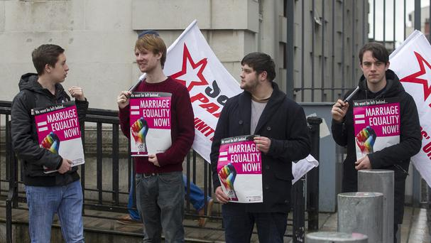 Campaigners for gay marriage stand outside Belfast's High Court