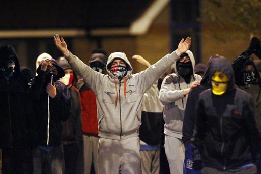 Youths congregate at the Short Strand in 2011. One year later, an Orange parade passing the east Belfast enclave came under attack