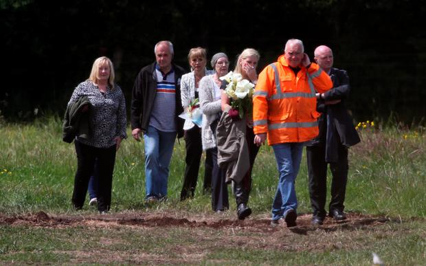 Relatives of Seamus Wright and Kevin McKee yesterday visit the site in Coghalstown, Co Meath, where two bodies were discovered on a reclaimed bog