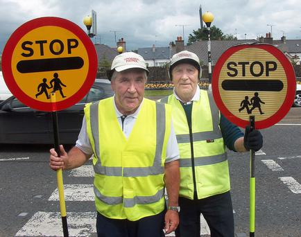 Brothers Pat and Jim Kerr at the school crossing at North Road, Ballymena