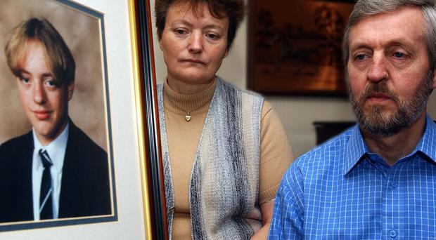 Hazel and Raymond Cairns with a photograph of their son Jonathan, who was beaten to death in 1999