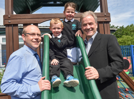 Cranmore Integrated Primary School principal William Doherty joins delighted pupils Noah Thompson and Cora Taggart in welcoming philanthropist Kevin Curley
