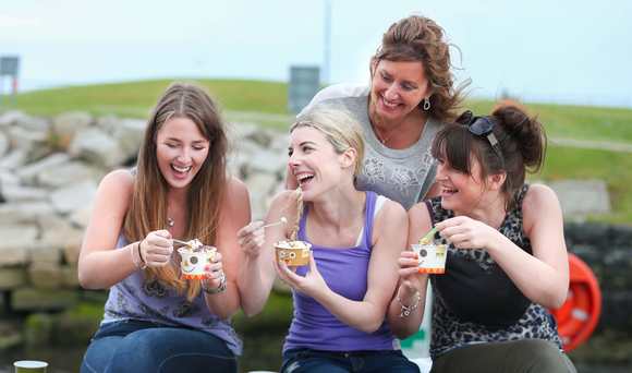 Patricia Pell, owner of Cafe Mauds in Newcastle, watches Naomi Costly, Clara Wilson and Vicky Patterson enjoy their ice creams
