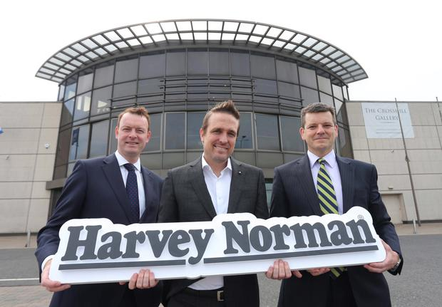Paul Wilson (director of Savills) Blaine Callard (CEO of Harvey Norman Ireland) and Colin Matthewson (CBRE) at the reveal of the new Harvey Norman location in Boucher Road, Belfast