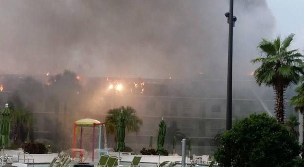 Firefighters work to contain the blaze at the Avanti International Resort in Orlando