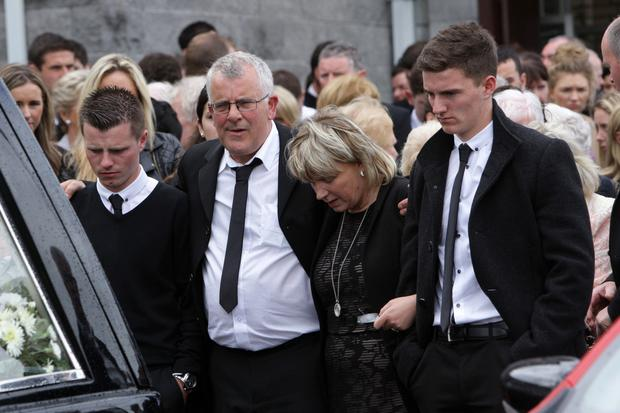 Eamonn Morgan's family walk behind Eamonn's coffin leaving the Church of St Brigid in Newry