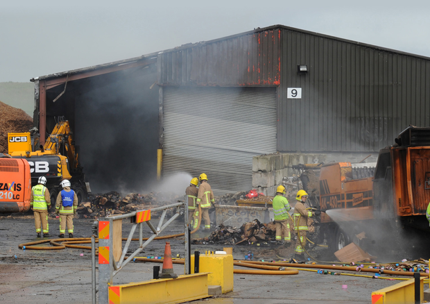 Fire officers tackle the blaze at the BricKKiln recycling plant at Heather Road outside Londonderry