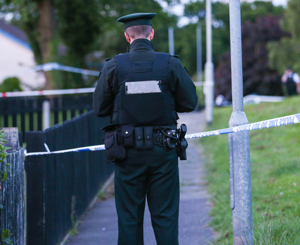 A police officer at the scene of the sword attack in south Belfast