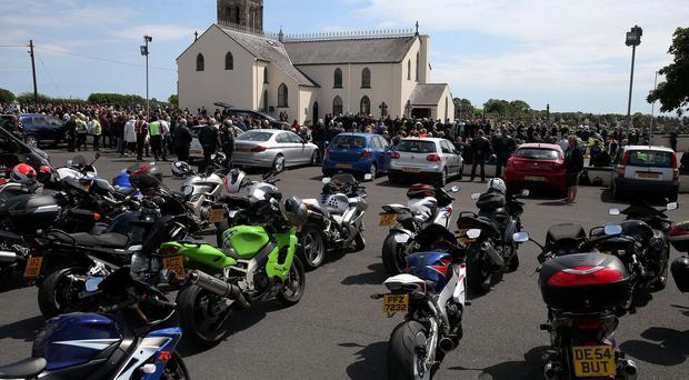 Motorcycles parked outside St Patrick's Church in Portaferry, Co Down, during the requiem mass of motorbike racing doctor John Hinds