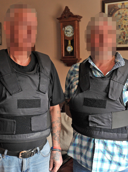 The two parade marshals wearing their bulletproof vests