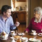 Noel McMeel enjoying tea and cake with his mother