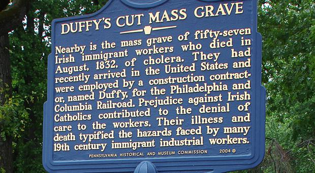 A sign at Duffy's Cut mass grave