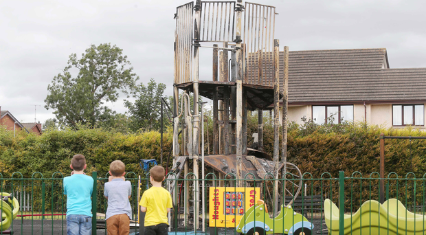 Youngsters yesterday survey the damage to the play park at Crossgar, which has infuriated local MP Margaret Ritichie