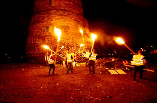 Bonfire builders get to work lighting the Ballymacash bonfire on Saturday night
