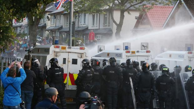 Water cannon is used on Loyalist protesters on the Crumlin Road, Belfast