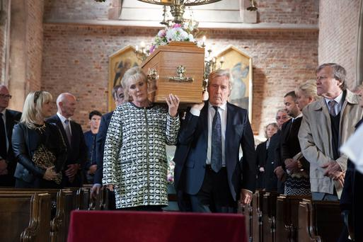 Liz McDonald and Ken Barlow carry Deirdre's coffin down the aisle
