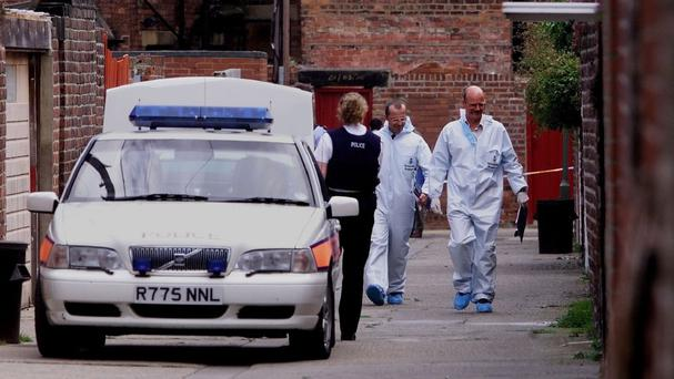 Police officers at the scene in Whitley Bay, Tyneside, where IRA informer turned author Martin McGartland was shot