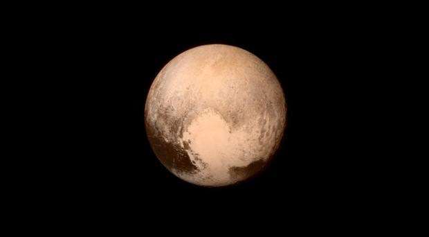 Scientists at the Johns Hopkins University in Maryland celebrate the arrival of pictures of Pluto from the New Horizons spacecraft yesterday