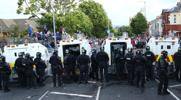 The crowd that confronted police lines on Woodvale Road