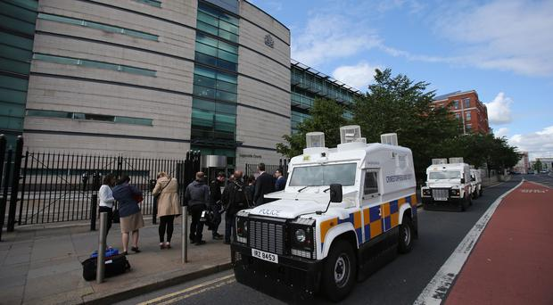 The police presence outside Belfast Magistrates' Court as prominent Orangeman John Aughey was granted bail