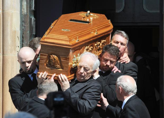 Jim McCauley helps to carry his son's coffin last month