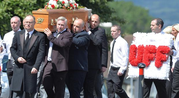 A UFF wreath is carried at the funeral of Lindsay