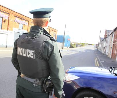 A police officer at the scene of the dissident attack in Lurgan on Saturday