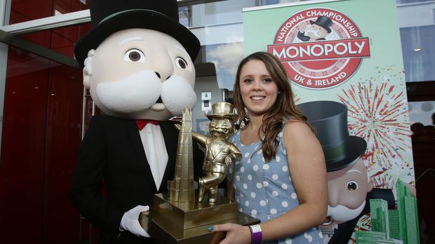 Natalie Fitzsimmons, 24, from Saintfield, Northern Ireland, with her trophy after winning the UK and Irish finals of the Monopoly World Championships, at The View from The Shard in London