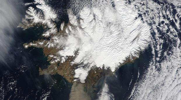 Ash billowing from the Eyjafjallajkull volcano in Iceland during 2010, viewed from a Nasa satellite.
