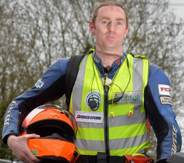 Dr John Hinds in his familiar bike doctor gear
