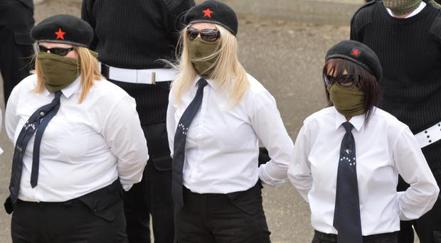 Women wearing paramilitary uniform at the funeral of Peggy O'Hara in Londonderry on Saturday