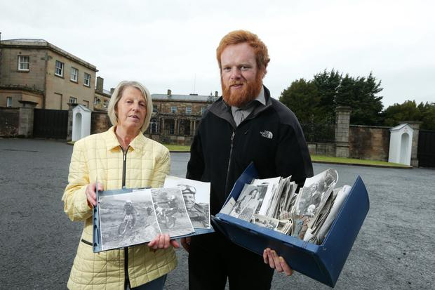 Melven James and Kris Campbell yesterday with the recovered photographs