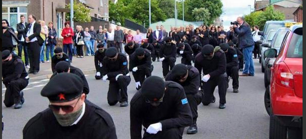 Scenes from the funeral of Peggy O'Hara in Derry with up to 100 masked paramilitaries on show.