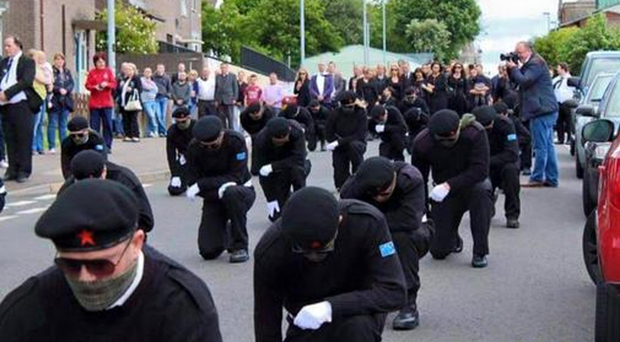 Scenes from the funeral of Peggy O'Hara in Derry with up to 100 masked paramilitaries on show