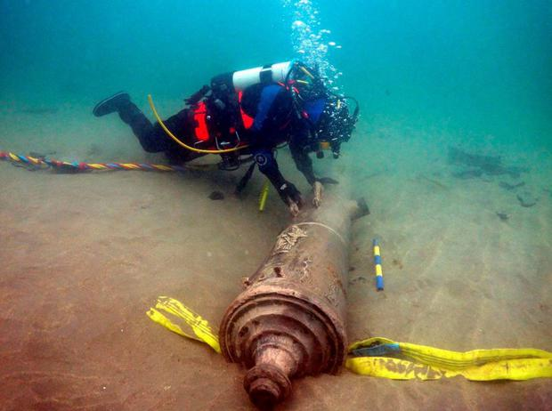 A diver inspects the sunken Armada cannon