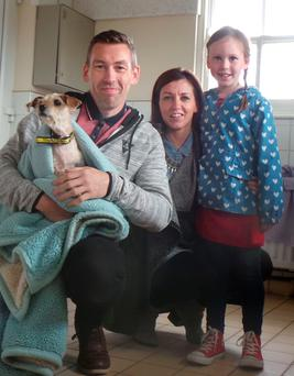 Ken Ross, partner Nicky and their daughter Darcy with April, who has been reunited with her owners after she was abandoned at a shelter