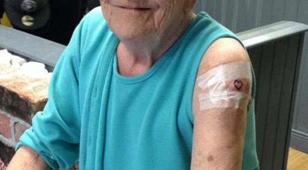 Grandmother Sadie Sellers has her tattoo done at Studio 76
