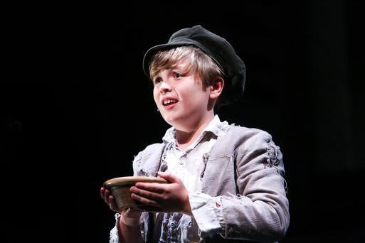 Conor Cox in the title role of Oliver