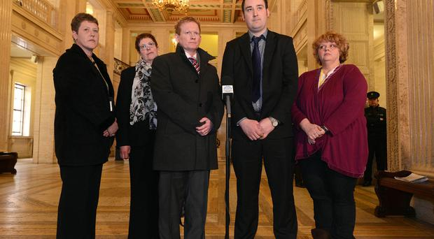 Taking a stand: Kenny Donaldson (second from right) of Justice for Innocent Victims with, from left, victims' relatives Margo Heatherington, Shelley Gilfillan, Stephen Gault and Aileen Quinton at Stormont