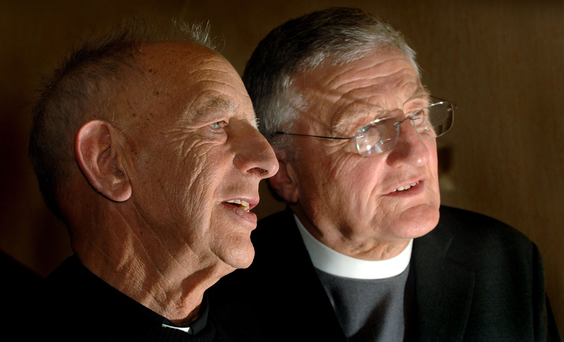 Fr Alex Reid and Rev Harold Good (far right) who watched as IRA weapons were destroyed in 2005