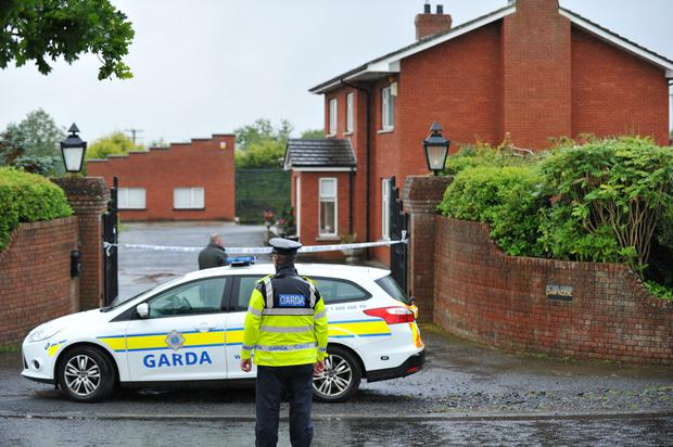 Gardai at the house yesterday where the body of a woman was discovered