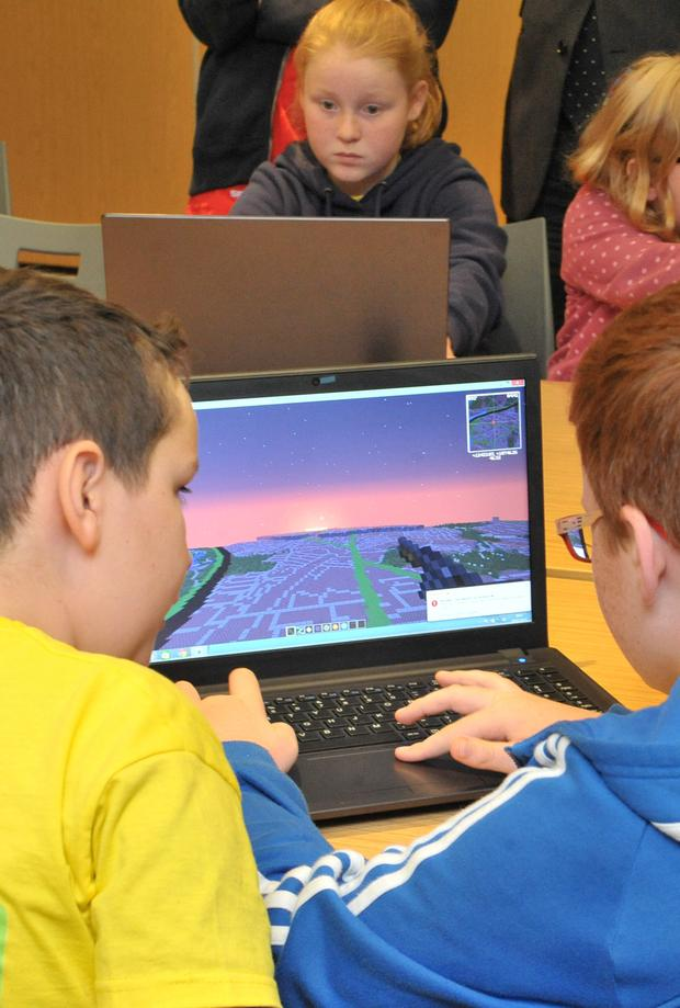 Local schoolchildren try out Minecraft Northern Ireland at the launch in the Stormont Pavilion