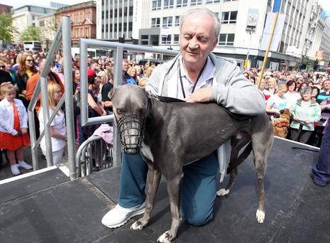 George Anderson with Norman at a rally in Belfast last year to protest against animal cruelty