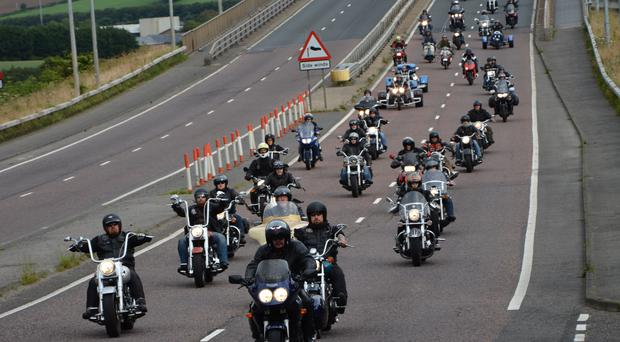 The motorcycle cavalcade for the late Shaun Kelly makes its way across the Foyle Bridge