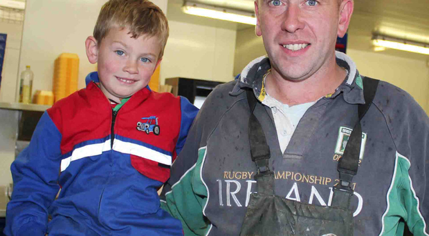 Castlerock dairy farmer Ian Pollock with Sam, one of his three sons