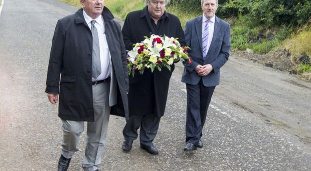 Des Lee, Ray Millar and Stephen Travers walk along the stretch of road where 40 years ago they lost three members of their band