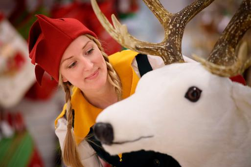 A Christmas elf with a toy reindeer as Selfridges launches its Christmas Shop at its flagship store in London