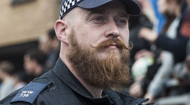 The picture of heavily-bearded Met Pc Peter Swinger that went viral