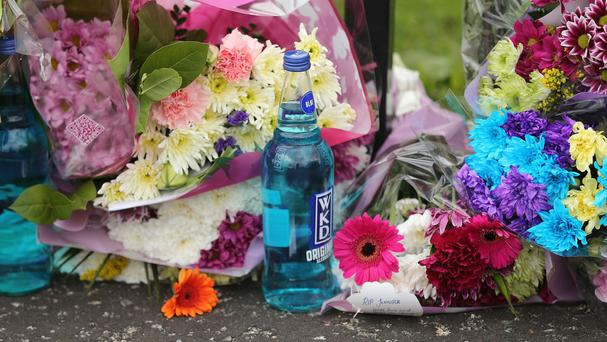 Flowers at the scene of the house fire in Hazel View Jennifer Dornan was found dead