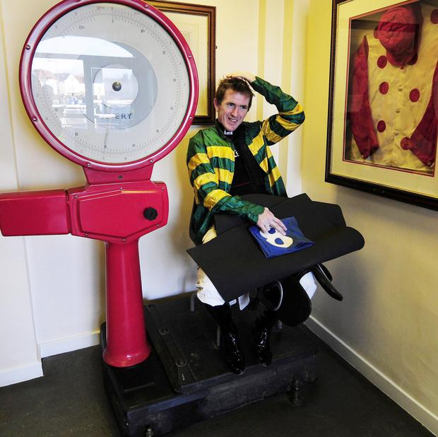 Tony McCoy sits on the scales at Catterick Bridge Racecourse in north Yorkshire in 2013